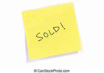 "Sold! - Sticky post it note with ""Meeting\"" wording."