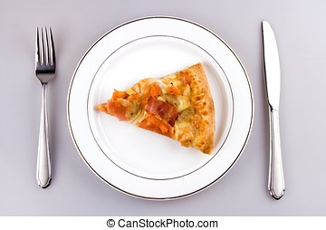Pizza on plate - A piece of pizza with place setting