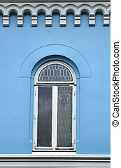 Blue wall and a beautiful window - Nice window in an old,...
