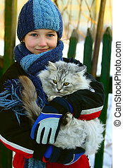The girl and a cat - The girl holds on hands of a cat