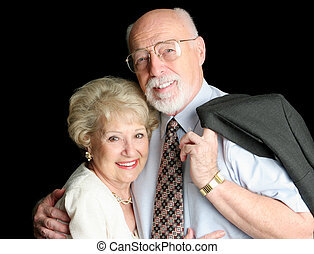 Elderly Couple - A loving, handsome senior couple on a black...