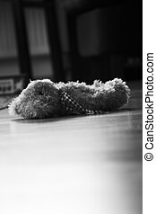 sad lost teddybear - b/w image of a teddybear abandoned on...