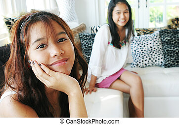 Beautiful Thai girls - Two sisters relaxing at home (focus...