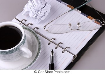 Frustration - Close up of eyeglasses, coffee, pen and...