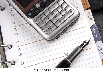 Mobile Phone and Organizer - Close up of mobile phone and...