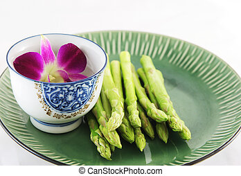 Fresh asparagus shoots on a plate