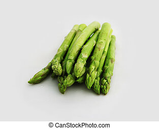 Fresh asparagus shoots on a white background - healthy...