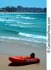 surf rescue - red boat with white sign: surf rescue, blue...