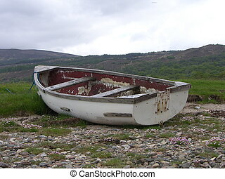 Beached Row Boat - Old row boat pulled up on shore and...