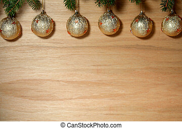 Golden christmas - Christmas bulb on a wooden desk...