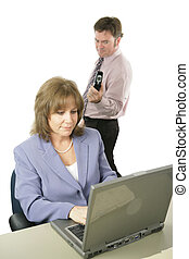 Corporate Espionage - A woman working, unaware that a male...