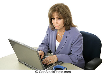 Female Executive Working Late - A mature female executive...