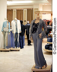 Shopping - People and mannequins in a fancy department store