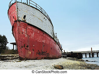 Ship ashore - Dilapidated old ship run aground.