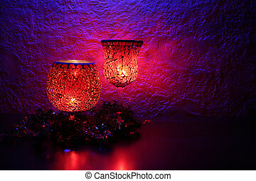 Candlelight - Candles on the left side of a shelf.