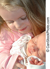 Sisters  - Young girl with her baby sister