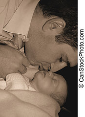 Fatherhood - Father kissing his daughter