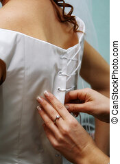 Soft focus lacing - Sister of bride lace up the corset of...