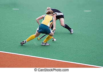 Hockey Players - Field hockey players contesting the ball
