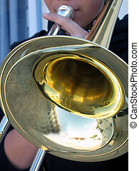 trombone - A young man playing a trombone