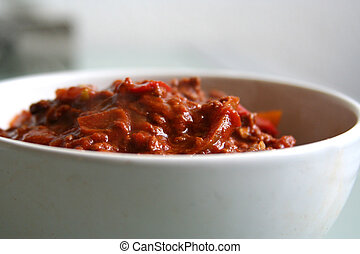 chili con carne - deliciously hot foot in white bowl