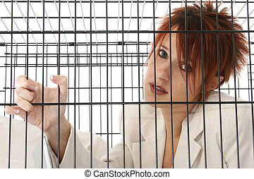 Caged - Thirty something business woman trapped in cage.