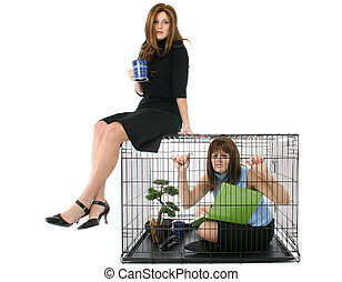 Caged - Thirty something business woman sitting on cage with...