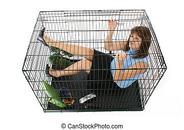 Caged - Twenty something business woman trapped in cage.
