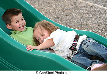 Sliding Siblings 5 - Smiling young brother and sister...