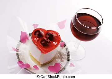 Red Wine With Dessert - A Red wine with love shape dessert.