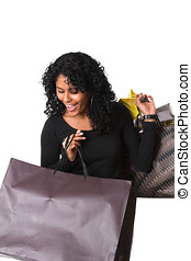 Happy shopper - Pretty girl walking around with a lot of...