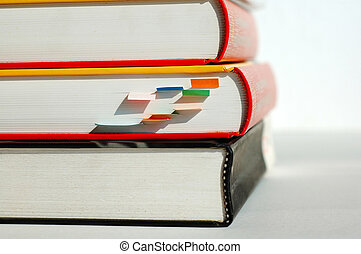 Three pile books - Three books are piled together, and the...