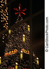 show-window - The New Year tree is reflected in glass of a...