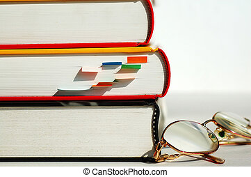 Three books and glas - Three books and a pair of glasses