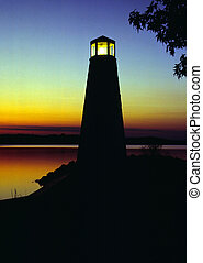 Lighthouse at Sunset - A small lighthouse at sunset. Located...