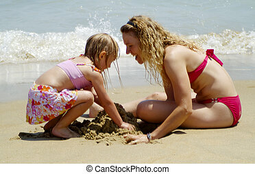 mother and daughter - Mother and daughter playing in the...