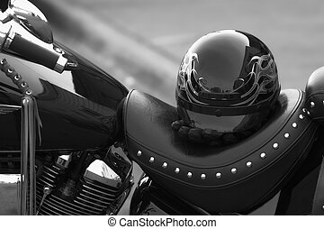 Helmut and motorcycle - Helmut and gloves on a seat of a...