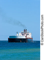 Large ship on lake agianst a clear blue sky with copy space