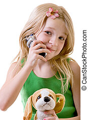eight year old on her cell - cute little eight year old girl...