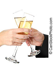 Celebration - Man and woman hands toasting with champagne