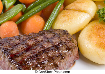 close-up of steak - a close-up picture of a steak dinner
