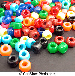 Pony Beads - A whole bunch of colorful plastic pony beads,on...