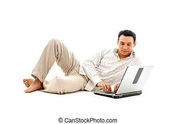 relaxed man with laptop computer over white