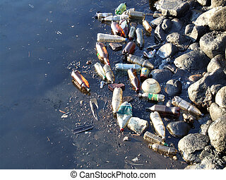 Polluted water in a harbor - Water pollution - old garbage...