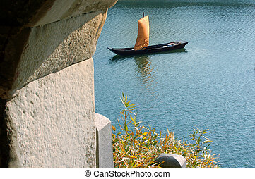 Asian Boat - An old asian boat seen looking through a stone...