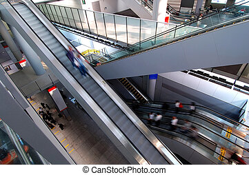 Escalators in airpor - Motion of people with escalators in...