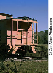 Caboose - An old caboose sits on permanent tracks.
