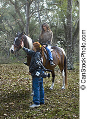 Petting the Horse - The photographer pets the horse while...