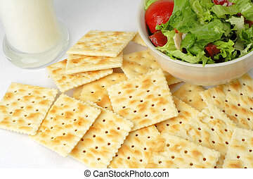 Healthy diet food - Crackers,vegetable salad and a glass of...
