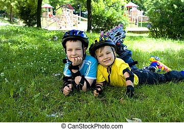 boys - brothers in a park